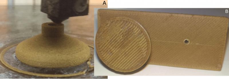 Un pomo de la impresa en 3D con el filamento de madera.