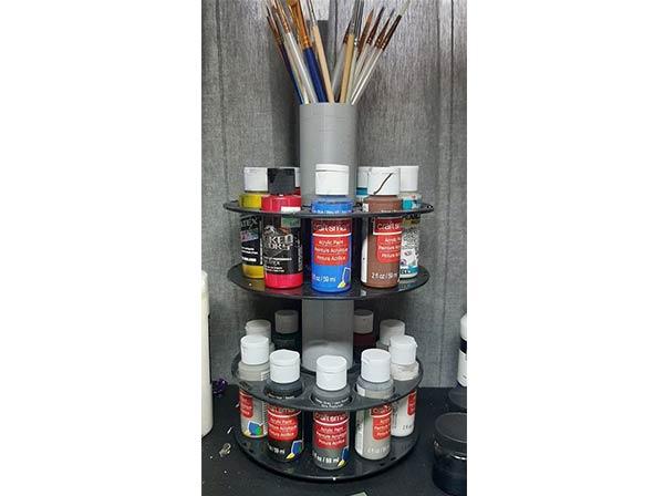 Almacenador pintura con bobinas reutilizadas